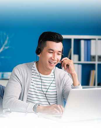 picture of person on computer with headset